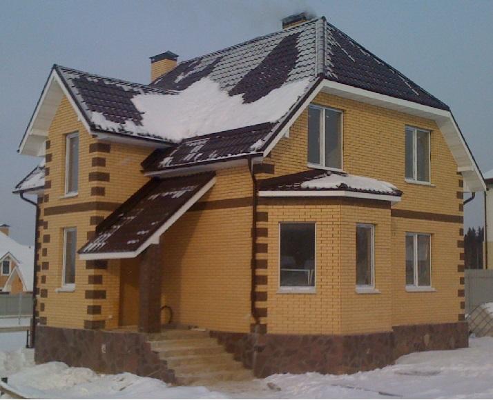 Монолитный дом облицованный кирпичем