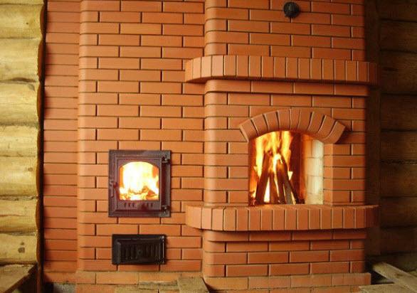 Обложенная кирпичом печь или камин – наиболее оптимальный вариант отопления в загородных строениях.